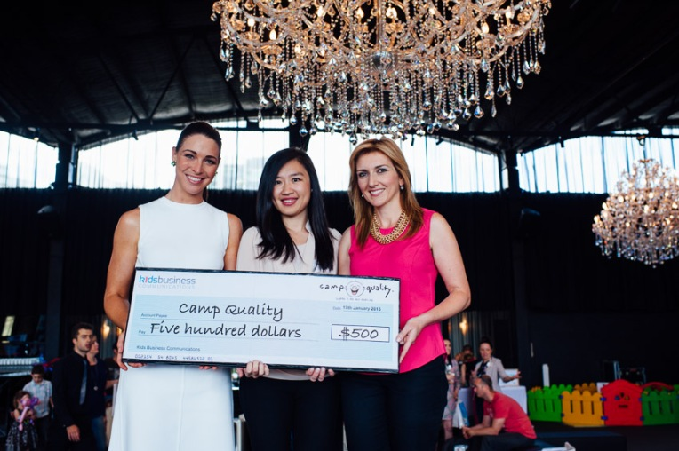 Giaan and Christie present a cheque for $500 to Camp Quality. Photo credit: Kids Business